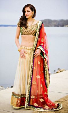 Cream, gold and red lehenga