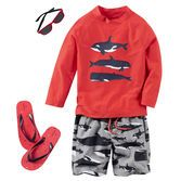 With cute whales, cool shades and flip flops to match, he's beach bound in style.