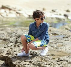 test the waters in bright swim trunks & a cool denim shirt.
