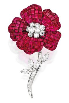 PLATINUM, RUBY AND DIAMOND BROOCH, OSCAR HEYMAN & BROTHERS. Designed as a longstem flower, the petals set with numerous calibré-cut rubies weighing 73.98 carats, centered by nine round diamonds weighing 2.65 carats, the stem and leaves set with baguette, tapered baguette and marquise-shaped diamonds weighing 3.30 carats, with maker's marks for Oscar Heyman & Brothers, numbered 200330; stem detachable. With signed pouch.