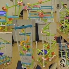 Paper Roller Coasters - A STEM Activity - Create a roller coaster from card stock and tape with at least one trick maneuver.  Then calculate the average speed of the marble.