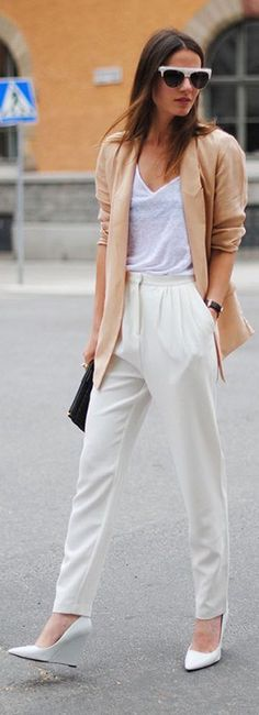 Zina Charkoplia of Fashion Vibe wearing a tan blazer, white shirt and off-white trousers, and white wedges