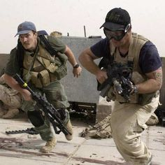 Blackwater contractors take part in a firefight as Iraqi demonstrators loyal to Muqtada Al Sadr attempt to advance on a facility being defended by U.S. and Spanish soldiers in Najaf, Iraq, April 4, 2004
