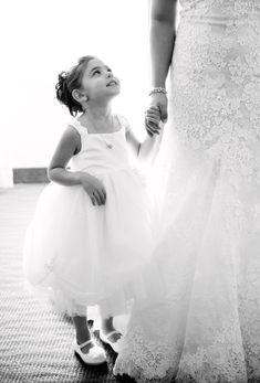 Flower Girl Looks Up at Bride  Photography: Ryon:Lockhart Photography Read More: http://www.insideweddings.com/weddings/brittany-pinto-and-joe-panik/1086/