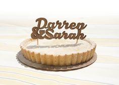 Custom laser cut cake topper (longer names). $47.00, via Etsy.