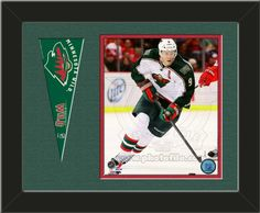 One framed 8 x 10 inch Minnesota Wild photo of Mikko Koivu with a Minnesota Wild mini pennant, double matted in team colors to 14 x 11 inches.  (Pennant design subject to change) $59.99  @ ArtandMore.com