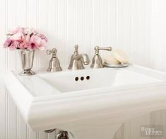 A white pedestal sink has a classic and versatile look that will withstand time and trend. With no base cabinet, the simple pedestal on the sink visually opens up the room. The pedestal sink was outfitted with the timeless appeal of a brushed-nickel faucet, and its wide rim is a perfect spot for pretty soaps or a small vase of flowers.