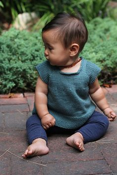 Ravelry: Like Sleeves for babies pattern by Yumiko Sakurai. Could easily be a dress if you knitted it longer!