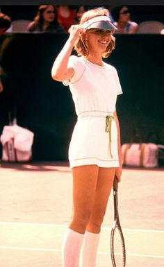 Olivia Newton John playing #tennis in 1976. Cute tennis outfit!