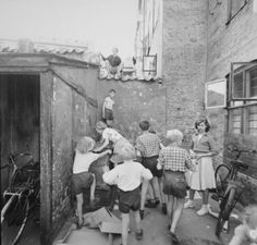 Children playing in an alley in Nørrebro (Copenhagen, Denmark).  Nørrebro is a vibrant area of Copenhagen only minutes away from the city center (1950-1960)