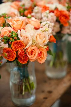 Tangerine, coral and pale peach roses.