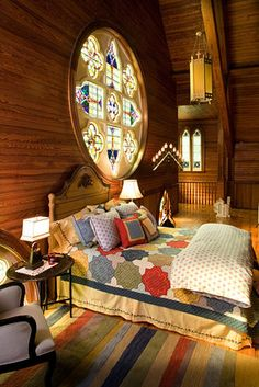 Once a Roman Catholic church, this 5,600-square-foot home on more than an acre in Meredith, N.H., features original stained glass windows an...
