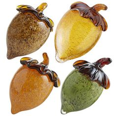 As beautiful and important as they are in nature, acorns deserve to be celebrated with special materials and artistic consideration. Our assortment is made from beautifully marbled amber, verdigris and java glass, as well as crackled amber glass. Place your collection in a centerpiece or on a mantel or countertop.