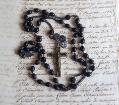 Antique French roman catholic rosary necklace jewelry with silver medal, black wooden carved gutta percha beads, metal Jesus Christ crucifix