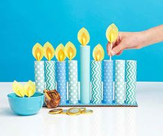 Holiday Crafts for Kids Cotton swabs form the flames for this menorah that kids can with patterned scrapbook paper.Cotton swabs form the flames for this menorah that kids can with patterned scrapbook paper. Hanukkah Crafts, Jewish Crafts, Hanukkah Decorations, Holiday Crafts For Kids, Christmas Hanukkah, Happy Hanukkah, Hannukah, Holiday Fun, Christmas Crafts