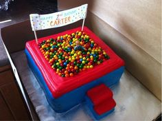 Ball Pit cake!! - a double 10 inch square white cake, homemade vanilla cream frosting, sixlets candy and a hand written banner (edible paper and edible marker) glued with piping gel to the lollipop sticks. the stairs are iced rice krispie treats...and a polly pocket doll!