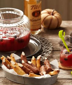 @titosvodka Blood Red Punch is a hit for any party! Pair it with our witch finger cookies and you've got drinks + treats covered!