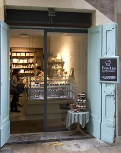 Florentine Cupcakes & Cookies | Barcelona...love the sliding real doors behind the pretty ones!