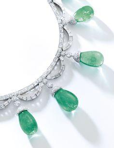Emerald and diamond necklace, Bulgari. Set with brilliant-cut and baguette diamonds, supporting seven drop-shaped emeralds capped with brilliant-cut diamonds.