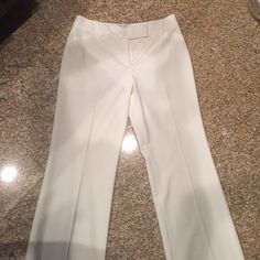 White House Black Market off-white pants White House Black Market Off-white/ cream colored 60% polyster pants.. Dressy tailored pants... Fully lined ! Have been worn, but almost new !! White House Black Market Pants Straight Leg