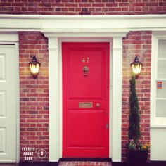 I love this photo with this bright red door!   Doors and Portals ...