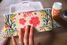 This DIY baby wipes container craft will put the finishing touch on your nursery decor. DIY baby wipes container craft to match nursery decor. Use Mod Podge to add pretty fabric to refillable baby wipes containers - no need to hide your wipes box anymore! Baby Wipe Box, Wipes Box, Wipes Case, Baby Wipe Holder, Baby Wipe Case, Plastik Box, Baby Wipes Container, Little Mac, Mod Podge Crafts