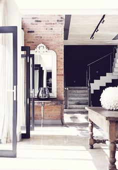 Polished concrete floor, exposed brick, black walls.