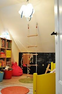 blackboard in smaller play room with the ladder and above nook area.