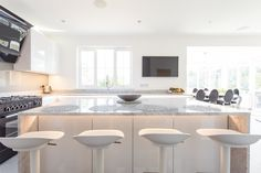 Handleless German Nolte Kitchen in Lux Gloss White with Matrix Art under counter lighting and a marble worktop. White Gloss Kitchen, White Marble Kitchen, Under Counter Lighting, Marble Worktops, Kitchen Ideas, Kitchen Design, German Kitchen, Bespoke Kitchens, Work Tops