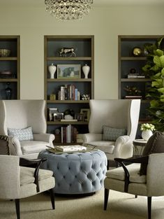 modern shelves,wingback chairs, ottoman, neutral scheme, classic