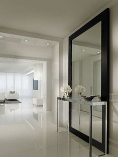 , Contemporary Hallway Design Ideas With Stainless Console Table Also Huge Modern Mirror With Black Frame Also White Tile Floor Also White Wall Paint Color Also Small Ceiling Lights Also White Modern Furniture: Hallway designs to Make Your House Better #blackmodernfurniture #hallwayideas #hallwayideassmall