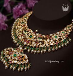 gold antique peacock and floral design necklace adorned with polki diamonds, rubies, emeralds, hanging green beads and south sea pearls by PMJ jewels. Antique Jewellery Designs, Gold Jewellery Design, Beaded Jewelry, Gold Jewelry, Gold Necklace, Emerald Necklace, Bead Jewellery, Short Necklace, Beaded Choker