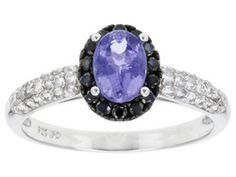.80ct Oval Tanzanite With .40ctw Round White Zircon, And .15ctw Round Black Spinel Silver Ring