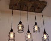 Upcycled Wood Chandelier with Mason Jar lighting. $375.00, via Etsy.