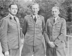 SS security chief and the driving force behind the Reich's extermination policies Reinhard Heydrich together with the Commander of the Security Police and SD in Prague Dr. Horst Böhme (left)  and the State Secretary Karl Hermann Frank (right). Heydrich was assassinated in 1942. Böhme was last seen during fighting near Konigsberg in April 1945. Frank was hanged for his war crimes by the Czechs in 1946.