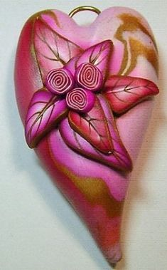 There's so much to keep the eye moving with this Dynamic Heart Pendant! Polymer clay jewelry making allows you to create any shapes and designs your heart desires, and this pendant is one imaginative project.