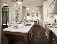 When a kitchen is at the heart of a large family living area, it often needs to blend with other more formal furnishings.  This kitchen, which was designed by Russell Dearsley of Downsview Kitchens, is in a French Provincial house that has a distinctly elegant feel.