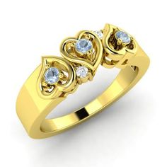 Anniversary Ring in 18k Yellow Gold with Aquamarine, SI Diamond. I like this ring (hint hint to my husband).