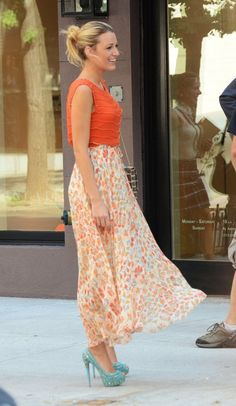 bright orange outfit and bright blue shoes