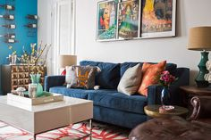 Although it's a studio, Cecily's space doesn't lack seating. Between the blue sofa and leather chair, there is plenty of space for guests.  Source: West Elm