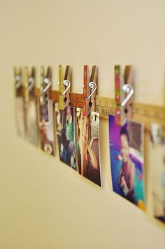 Love this photo display idea! Would be perfect for vintage long ruler that I have from my Grandparents that I wasn't sure what to do with!