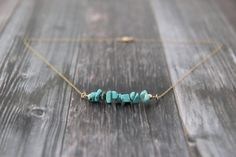 """Turquoise Chip Bead Necklace, Turquoise Chip Jewelry, Turquoise Bead Bar Necklace, December Birthstone, December Jewelry, December Birthday  Nice baby blue turquoise beads are pebble shaped, creating an organic look. Strung on a bead bar, these gemstones are """"free-style,"""" meaning they vary in size. Bar measures approximately 1 ¾ of an inch, and is capped by a 14k gold filled or sterling silver bead on either end.  Please choose your length and metal of choice from the drop down menu on the…"""