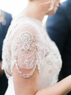 gorgeous jeweled detail on this capelet sleeve | Photography: Maria Lamb