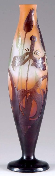 IMAGE: A wonderful Galle cameo vase having a deep brown foot extending upward to create detailed flowers and leaves