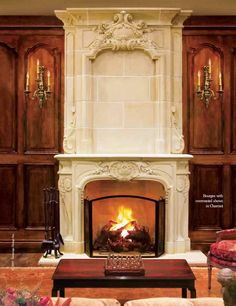Love, love this carved stone fireplace !