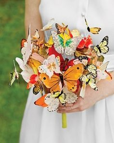 Non-Flower Bouquet Idea: Butterflies- what if you did this with cranes and origami flowers freeing up your backdrop for ribbons?