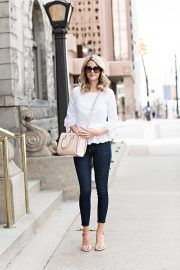 Emily Jackson has kept her cute spring outfit simple and effective by wearing minimal colours and choosing pastel accessories. This outfit - consisting of a pretty white blouse with denim jeans and sandals - is perfect for everyday spring sophistication. Top/Bag: Tory Burch, Jeans: Frame, Sandals: Stuart Weitzman.