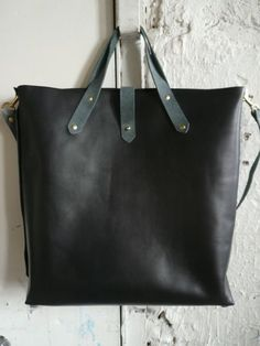Black and Gray Leather Tote | 29 Ideal Travel Bags For Your Next Trip