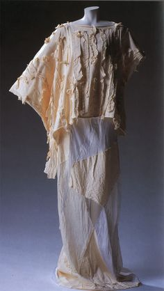 Comme des Garcons, 1983 S/S   Off white cotton jersey blouse with cotton ribbon applique, washed white patchwork dress of sheeting and rayon...