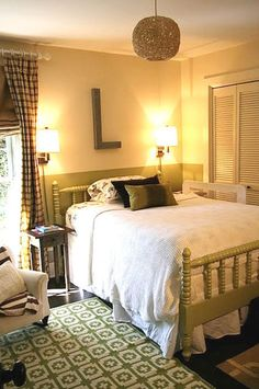 Eclectic bedroom in sage green, with Jenny Lind bed.